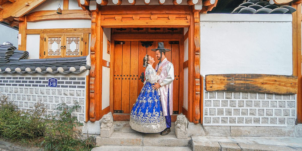 Couple looking at each other in traditional Korean clothes in Seoul during the Coronavirus outbreak