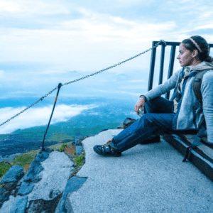 Woman climbing Mt Fuji at sunset