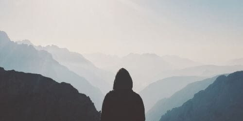 Guy overlooking mountain range