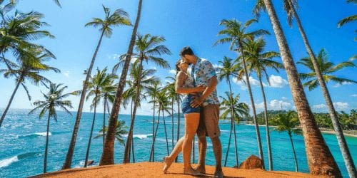Couple kissing on coconut hill in Mirissa Sri lanka