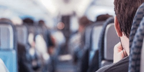 Guy in the aisle seat of a plane