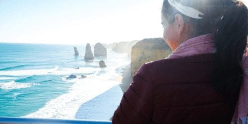 girl looking at the 12 apostles on the great ocean road
