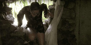 Girl climbing into the Cat Ba War Tunnels