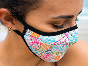 Girl on a beach wear a face mask preparing for travel after the pandemic