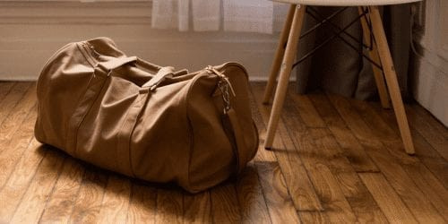 duffle bag on the floor before a flight